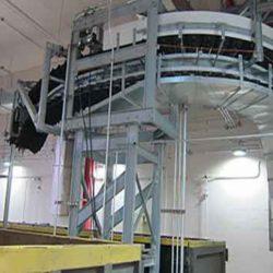 Serpentix Pathwinder conveyor system depositing sludge into a truck
