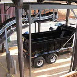 Serpentix Pathwinder FlexEnd conveyor system in wastewater treatment plant depositing into a truck