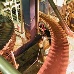 Serpentix Model-H conveyor carrying sludge to the deposit point